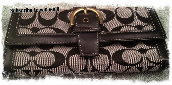 Coach replica wallet, 16 card slots, license slot, coin zipper section and two pockets for cash.  Gray and Black Coach cloth with copper colored fastener.