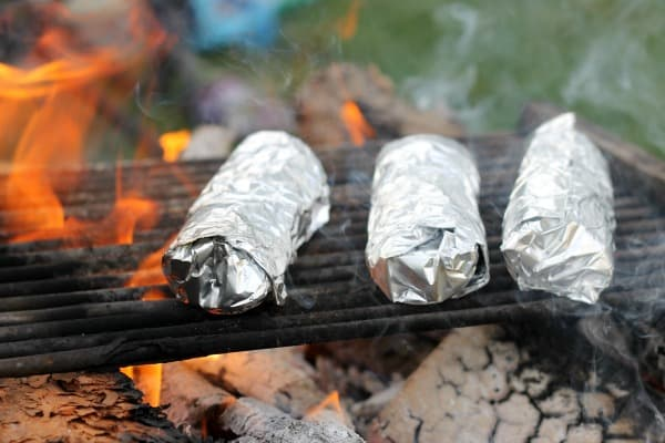 Easy recipes and fun games for a memorable backyard campout like breakfast burritos and campfire churros